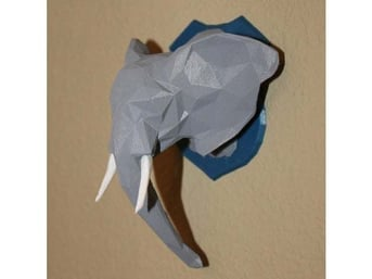 Painted low-poly elephant trophy.