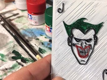 These Joker playing card props are modeled from the ones Mark Hamill's Joker had in Batman: The Animated Series.