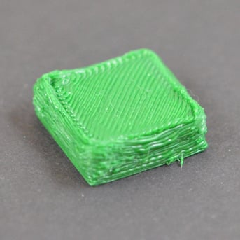 Over-extrusion on a 3D printed cube