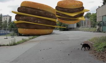 Some giant 3D burgers on a street