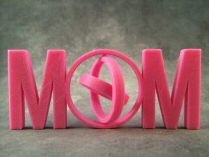 "You can spin it and it says ""MOM"".  (source: Thingiverse)"