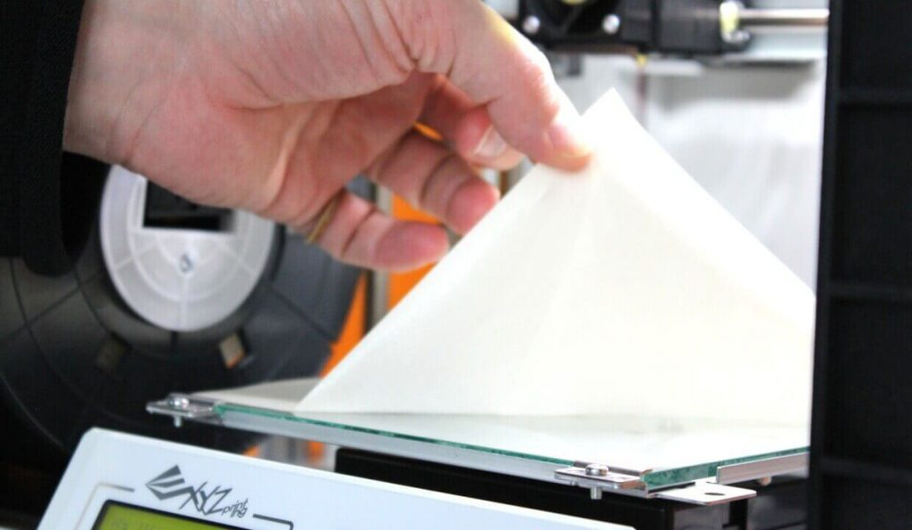 Adhesive tape to help with first-layer adhesion