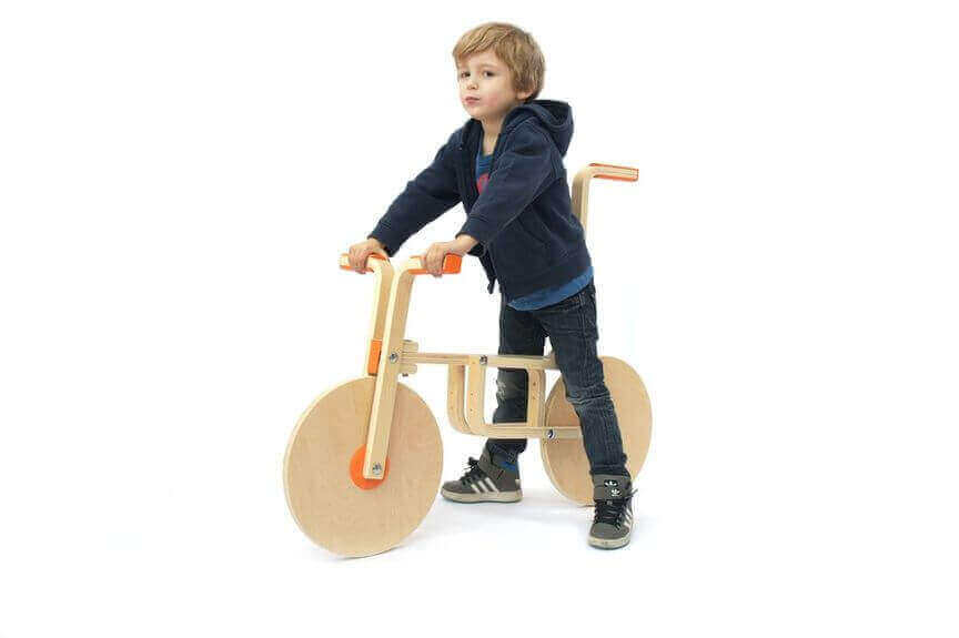 """A few 3D printed parts and two FROSTA stools can turn into a wooden """"draisine"""" for your kids (source: Ikeahackers)"""