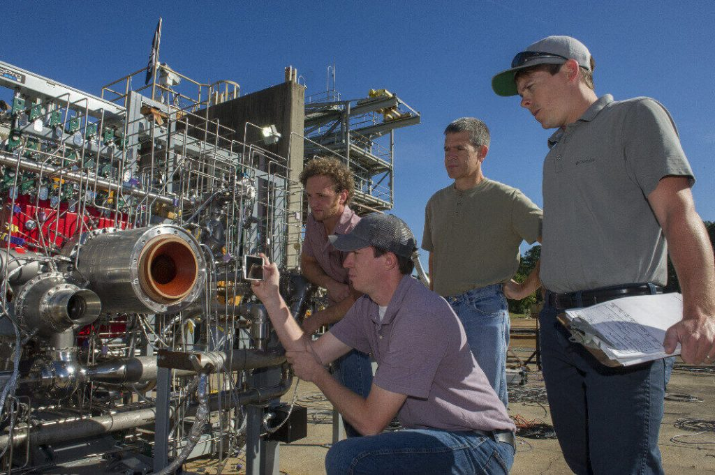 NASA 3D printed rocket: Engineers prepare a 3D printed breadboard engine made up of 75 percent of the parts needed to build a rocket engine for a test at NASA's Marshall Space Flight Center in Huntsville, Alabama (image: NASA/MSFC/Emmett Given)