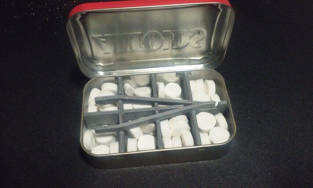tin divider with tweezers