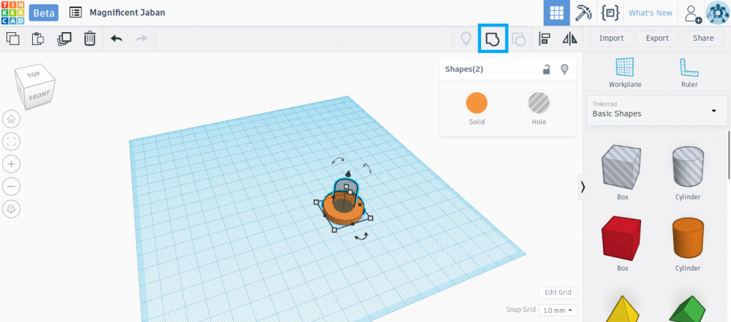 The Group button merges two Tinkercad shapes