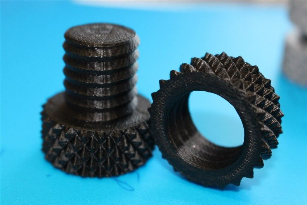 This nut and bolt was printed using black ABS plastic.