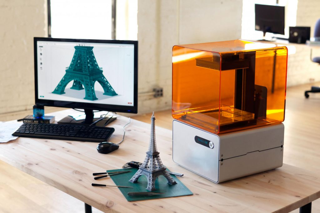 A 3D printer (machine on the right hand side) easily fits on a study table