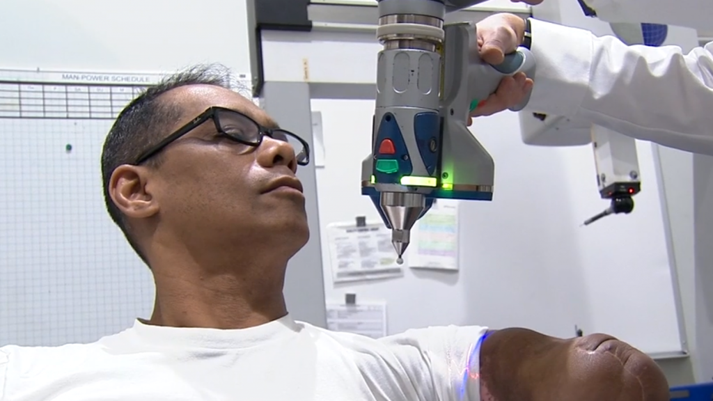Honda employees scan Tony's arm