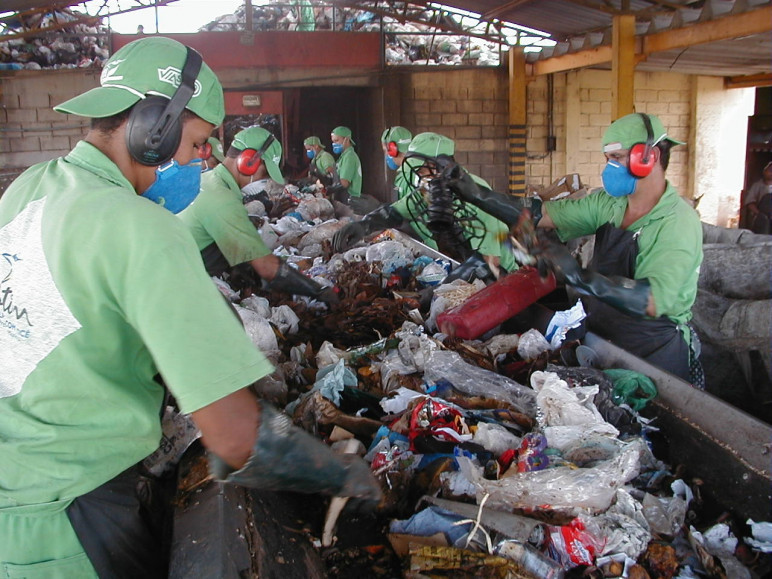 Recycling workers sorting waste by hand