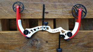Featured image of Weekend Project: Take Aim With a 3D Printed Miniature Compound Bow