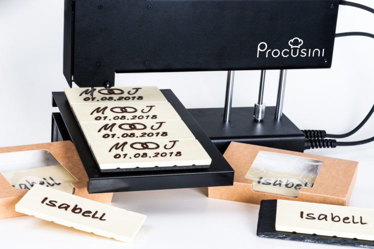 The Procusini 3.0 printing custom text onto chocolate.