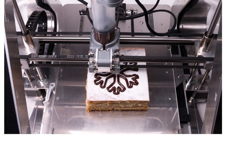 ZMorph's thick paste extruder printing a pattern onto some cake.