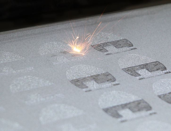 A close-up of a CO2 laswer fusing powder particles.