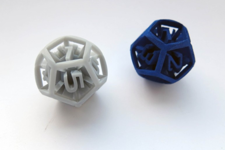 Two of the same part printed with SLS and SLA.