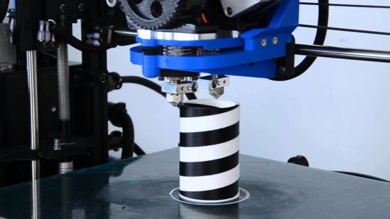 3D printing with a dual extruder 3D printer.