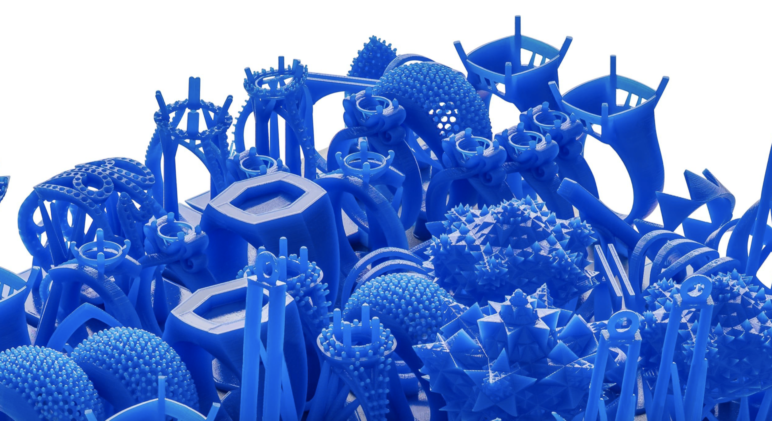 A pile of 3D printed pieces of jewelry.