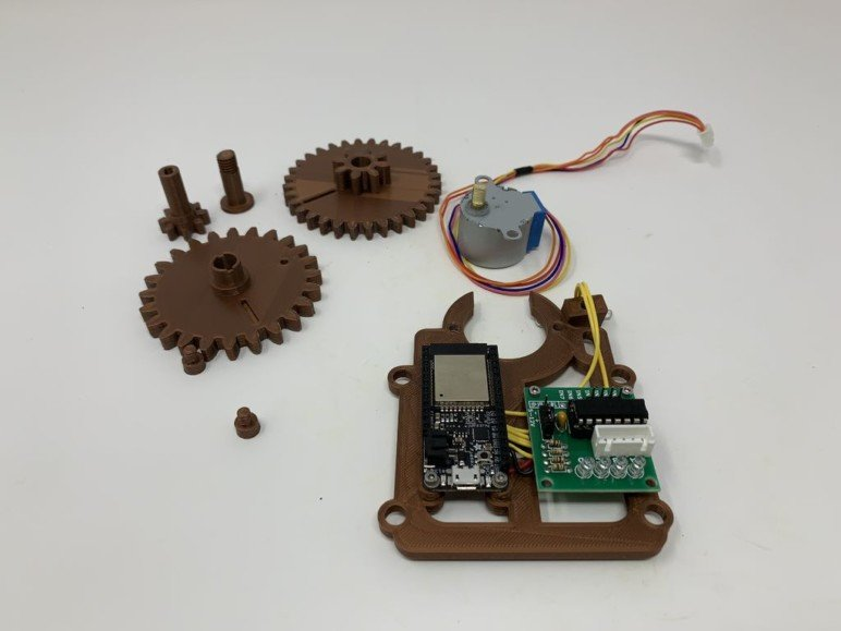 The 3D printed parts, motor, ESP32 Feather Board, and controller.