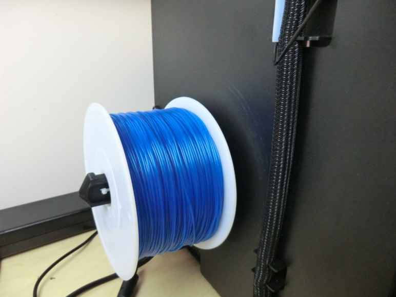 A spool of filament loaded on the printer.