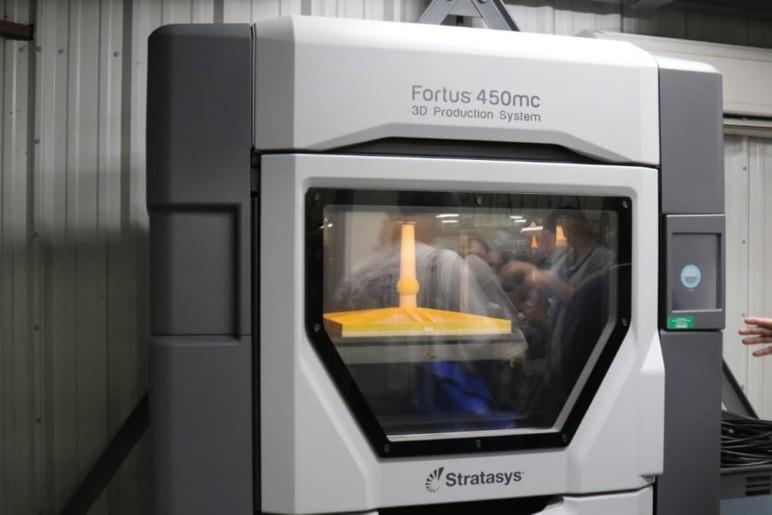 A large production 3D printer.