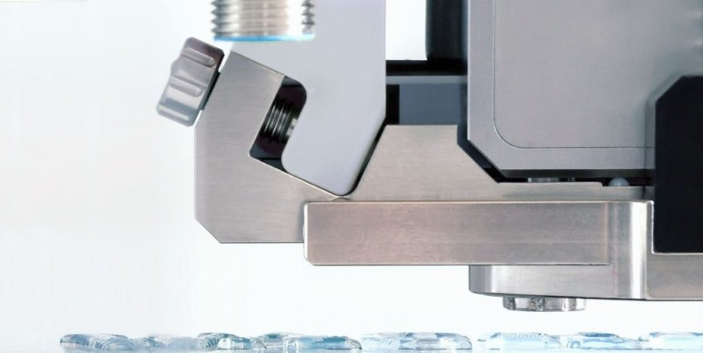 The head of an ACEO machine.