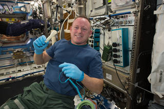 Astronaut Barry (Butch) Wilmore shows off the 3D printed wrench.