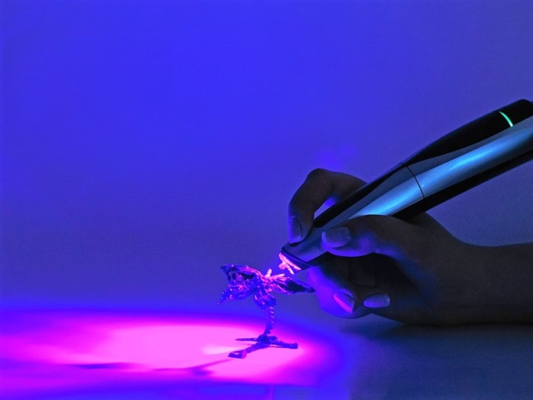 CreoPop's Cool Ink is hardened with a UV light source.
