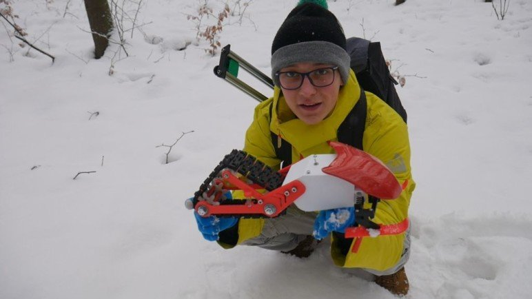 Nikodem Holding the Snowmobile