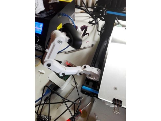 The camera mount with a Logitech webcam.