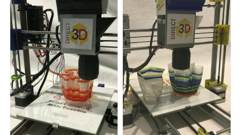 A 3D printer equipped with a pellet extruder.