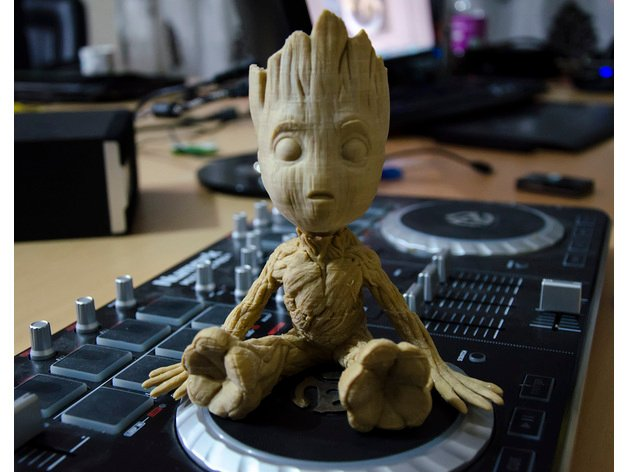 Baby Groot resting his limbs.