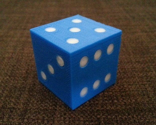 Some 3D printed dice come in two colors like this one.