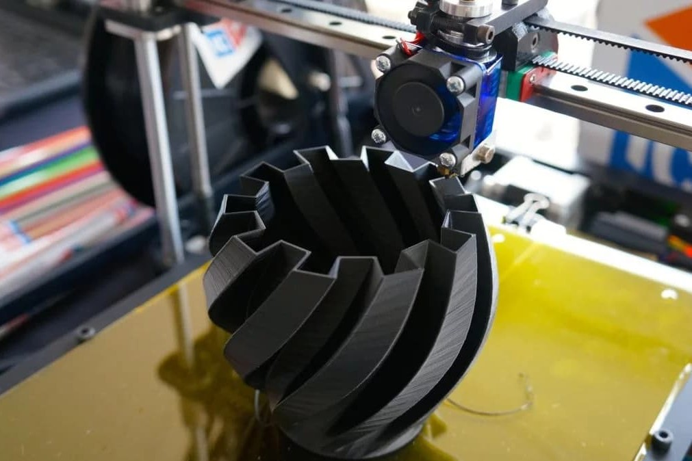 A vase being printed on an FDM machine.