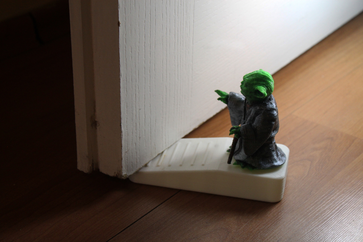 This Yoda will use the Force to keep your door at bay.