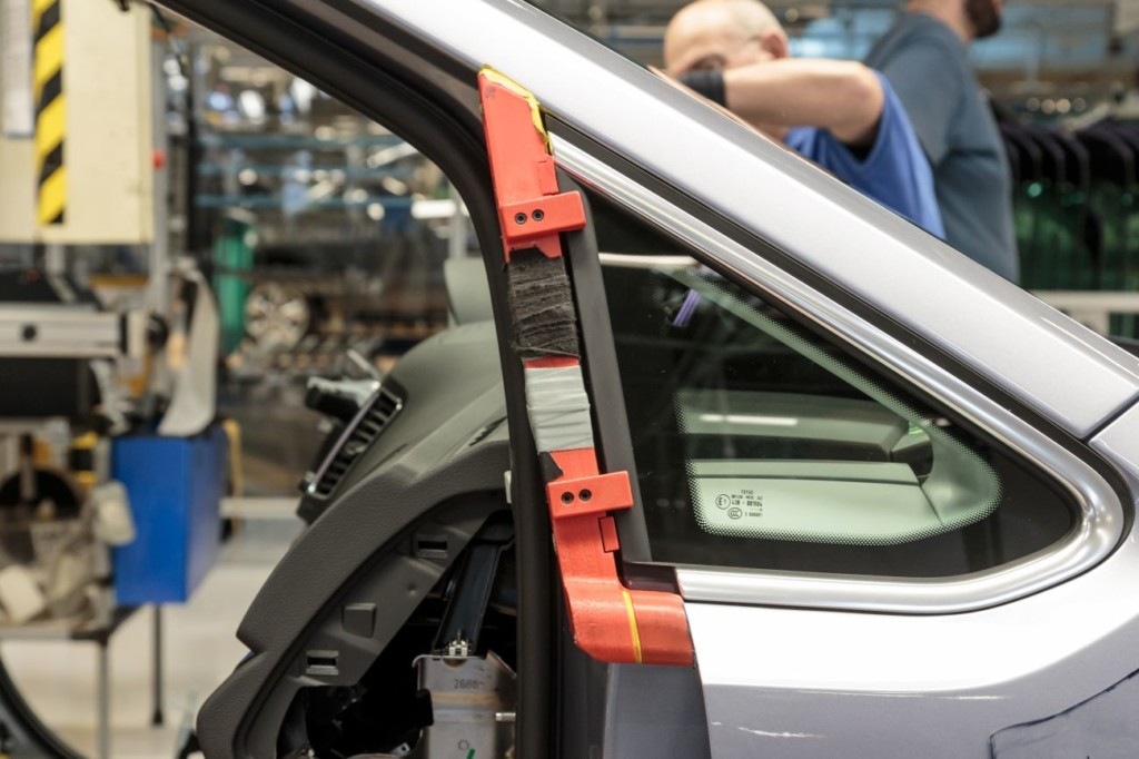 A 3D printed jig on a Volkswagen assembly line.