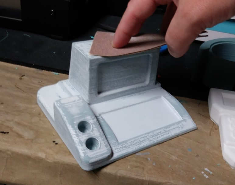 Sanding a primed 3D print.