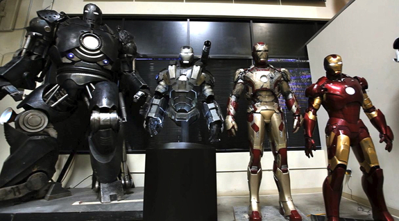 3D printed Iron Man suits on display.