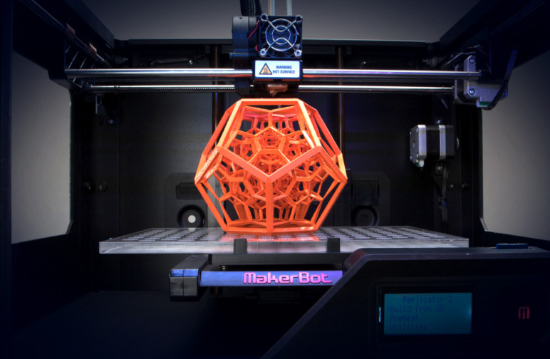 A MakerBot 3D printer near the end of a print.