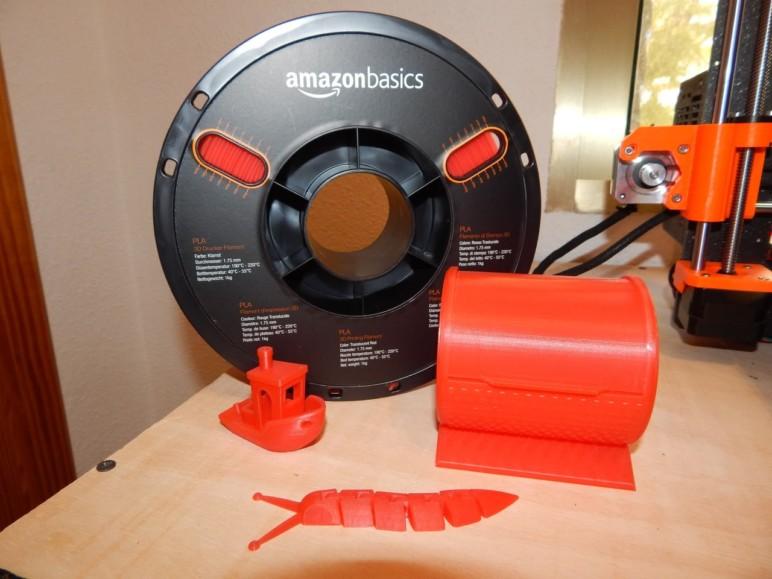 The spool of PLA alongside our test prints.