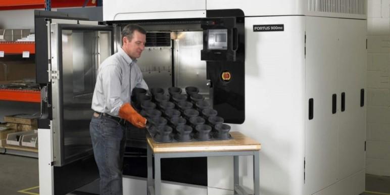 Industrial grade Stratasys 3D printer in use.