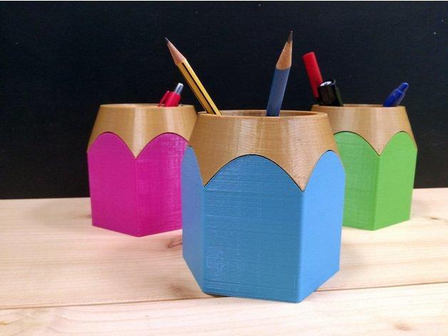A pencil pot holding pencils.