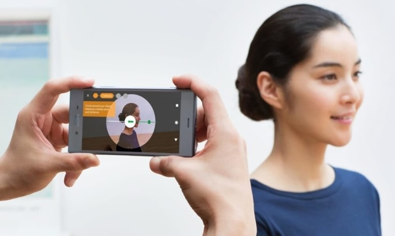 A person scanning a girl's face with a smartphone.