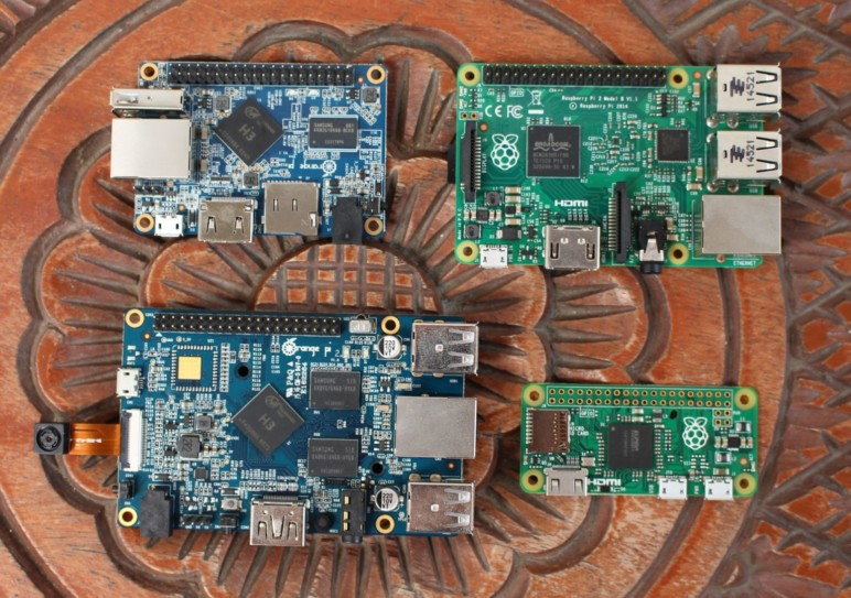 A couple Raspberry Pis fight off a pair of Orange Pis.