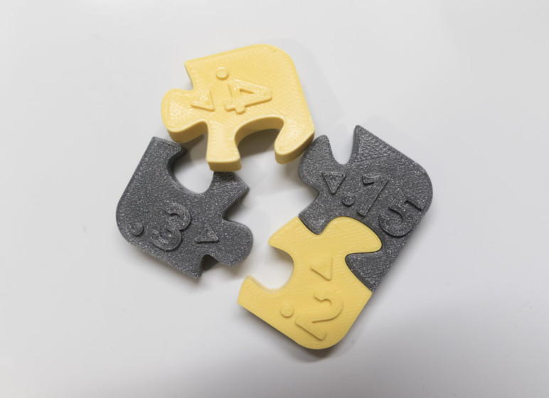 Puzzle pieces with different values of clearance.