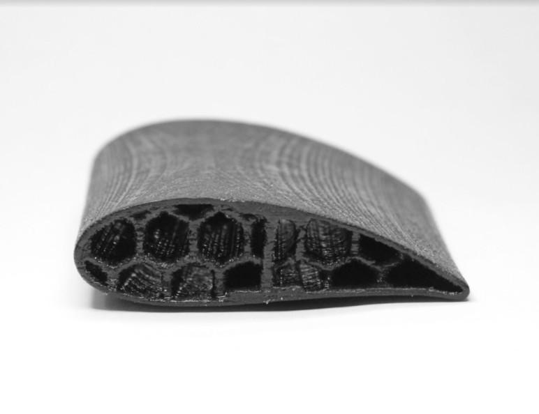 A machine piece 3D printed in Kevlar.