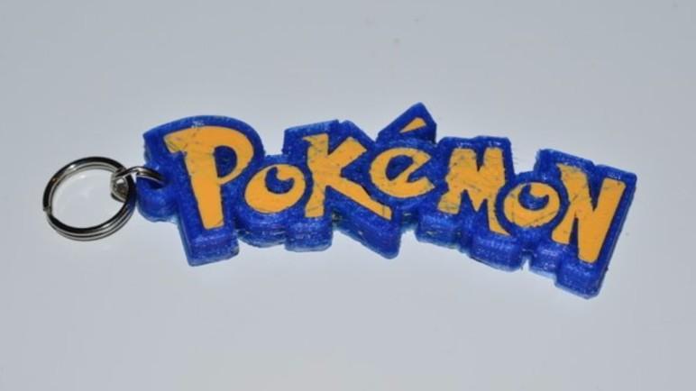Pokémon logo keychain printed on a dual extruder printer.