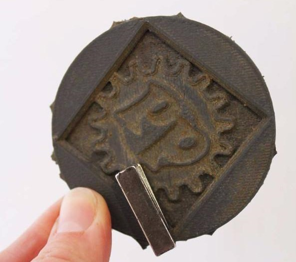 A magnet sticking to a print made with Proto-Pasta's special PLA.