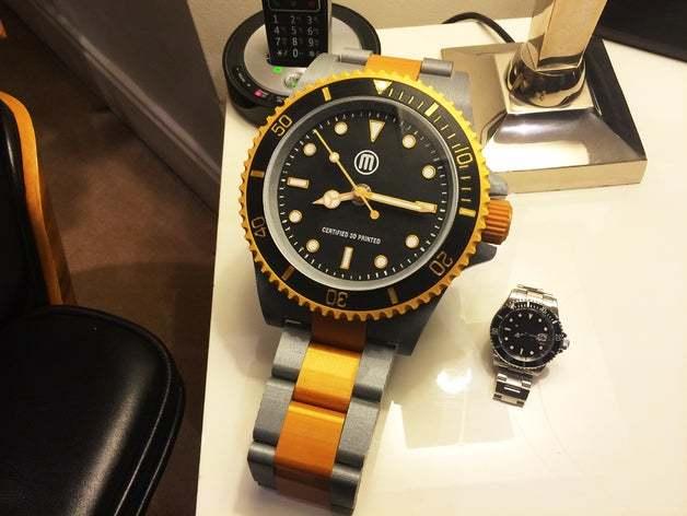 A huge 3D printed watch next to a regular watch.